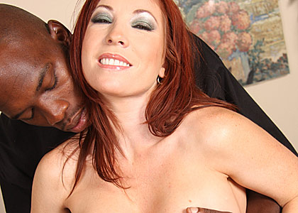 busty redhead MILF Britany gets banged by a big cocked black from Blacks on Cougars